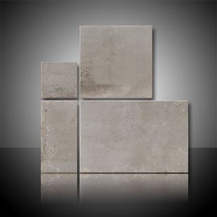Individual tiles of the Corten Grey Modular mix sizes.